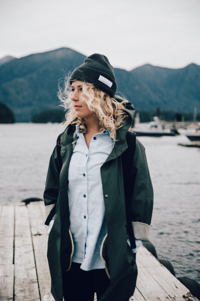 Girl in wind by lake, Anian Clothing